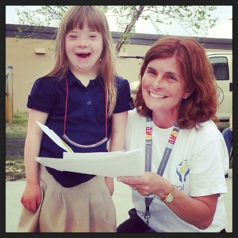 Hannah receiving an award 2 years ago from Mrs. Hazelip, the Director at her school!